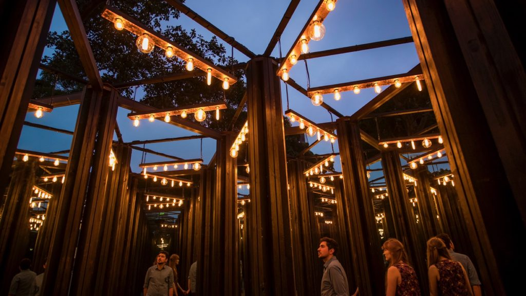 People wander through the House of Mirrors at Sydney Festival